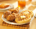 Chicken and waffles with sweet tea in background Stock Photo