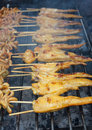 Chicken wing cooking on a grill stove thai style hot Royalty Free Stock Images