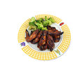 Chicken wing dinner meal of wingsand broccoli on a plate isolated on a white background Royalty Free Stock Images