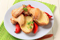 Chicken wings with baked potato and pepper Royalty Free Stock Image