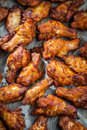 Chicken wings on baking sheet Royalty Free Stock Photo
