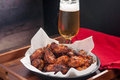 Chicken wings and beer tasy hot spicy with a cold Royalty Free Stock Photography