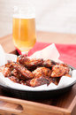 Chicken wings and beer tasy hot spicy with a cold Royalty Free Stock Photo