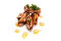 Chicken wings fried in honey sauce on a white background Stock Photo