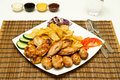 Chicken wings grilled with salad and fries Royalty Free Stock Photos