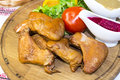 Chicken wings are grilled on the table in a restaurant Royalty Free Stock Image