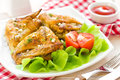 Chicken wings on a plate with vegetables Royalty Free Stock Image