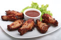 Chicken wings with red sauce on white plate Royalty Free Stock Image