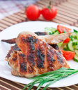 Chicken wings with salad on the white plate Royalty Free Stock Image