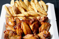 Chicken wings and wedges Royalty Free Stock Photo