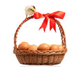 Chickens with basket сute little on eggs inside isolated on white background Stock Photo