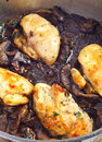 Chickens and mushrooms cooking vertical Royalty Free Stock Photos