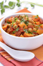 Chickpea sweet potato curry hearty healthy and in white bowl vertical format Royalty Free Stock Photo