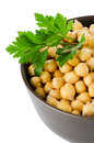 Chickpeas in a brown bowl isolated over white background Stock Photography