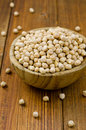 Chickpeas heap of raw in a wooden bowl Stock Image