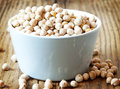 Chickpeas raw in a bowl on wooden background Royalty Free Stock Images