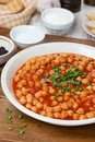 Chickpeas stewed in tomato sauce vertical close up Stock Image