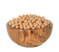 Chickpeas in a wooden bowl isolated on white background Stock Images