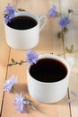 Chicory drink in two cups white and flowers Royalty Free Stock Image