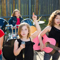 Chidren singer girl singing playing live band in backyard blond kid concert with friends Stock Image