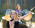 Chidren singer girl singing playing live band in backyard blond kid concert with friends Royalty Free Stock Photography