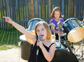 Chidren singer girl singing playing live band in backyard blond kid concert with friends Royalty Free Stock Image