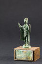 Chieftain praying with cloak and stick, bronze figurine Royalty Free Stock Photo