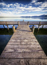 Chiemsee lake old wooden jetty at the in bavaria Royalty Free Stock Photo