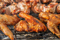 Chiken wings  and Juicy roasted kebabs and  on the BBQ Royalty Free Stock Photo