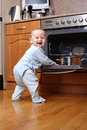 Child 1 year old in the kitchen cooking breakfast Royalty Free Stock Image
