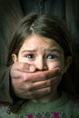 Child abuse scared young girl with an adult man s hand covering her mouth Stock Images