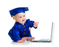 Child in academician clothes using laptop happy Stock Photography