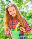 Child adorable kid hold flower pot and hoe gardening tool. Gardening is peaceful meditative occupation. Gardening Royalty Free Stock Photo