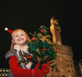 Child against Palazzo Vecchio in Florence with Christmas tree Royalty Free Stock Photo