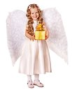 Child at angel costume holding gift box. Stock Images