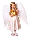 Child at angel costume holding gift box. Royalty Free Stock Photo