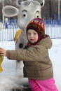 Child and animal roundabout little in winter Royalty Free Stock Image