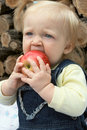 Child with the apple Stock Images