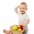 Child with apples Stock Photos