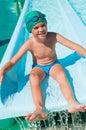 Child in aqua park Royalty Free Stock Photo