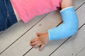 Child with arm cast a broken wearing a concept photo of children health care risk danger outdoor accidents game accidents Stock Photo