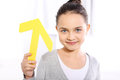 Child with arrow caucasian girl holding a symbol of the yellow pointing up Stock Photography