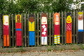 Child art displayed on wooden fence Royalty Free Stock Photo