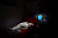 Child asleep dreaming of adventures night lightpainting photo a sleeping kid with an iluminated globe Stock Photo