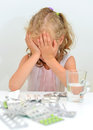 Child ate tablets dangerous situation at home Royalty Free Stock Image