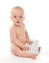 Child baby boy typing on computer keyboard Royalty Free Stock Photo