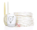 Child baby radio monitor stack of diapers nipple soother kid device on a white background Royalty Free Stock Photos
