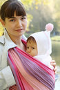 Child in a baby sling. Stock Images