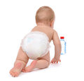 Child baby toddler crawling facing backwards from the back rear view for bottle of drinking water isolated on a white Royalty Free Stock Photography