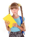 Child with backpack holding book. Royalty Free Stock Photo
